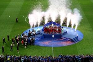 Jordan Henderson of Liverpool lifts the Champions League trophy.