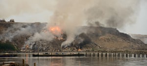 Fire burning at scrap-heap causing serious pollution to the environment.