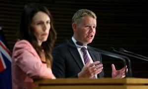 Minister for COVID-19 Response Chris Hipkins (right) speaks to media while Prime Minister Jacinda Ardern looks on