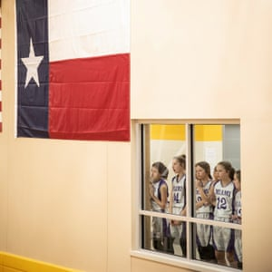 Players on the girl's junior high basketball team watch a game during a tournament at the Roberts County ISD School in Miami, Texas on 10 January 2019.