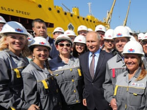 President Putin with workers in hard hats