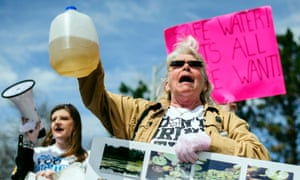 Flint residents protest about contaminated water outside City Hall in April 2015. Authorities did not change the water supply until October.