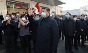 President Xi Jinping waves as he inspects the coronavirus prevention and control work in Beijing.