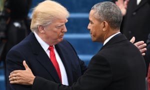 President Donald Trump shakes hands with Barack Obama after taking the oath of office.
