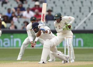 India's Virat Kohli plays and misses at the ball while batting during the first cricket test between Australia and India in Adelaide.