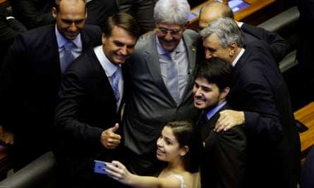 People pose for a picture with Jair Bolsonaro, second form left, at the house of representatives in Brasilia