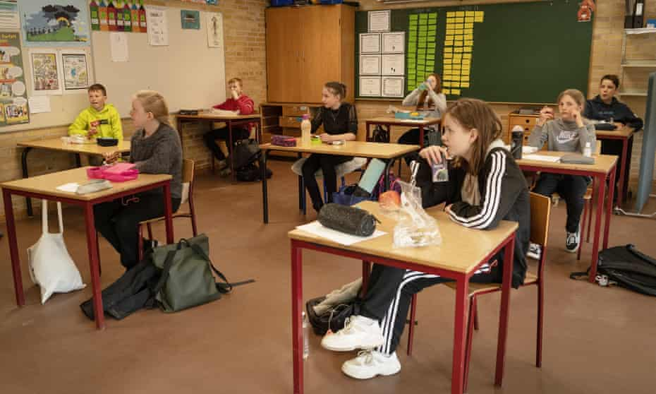 Students have a lunch at a school in Denmark