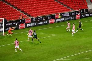 Kane shoots at goal.