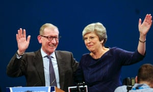 Theresa May and husband Philip wave to the crowd after her speech at the Conservative conference