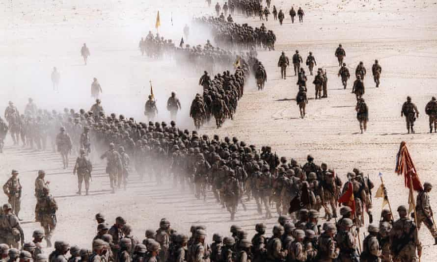 Responding to Iraq's invasion of Kuwait, troops of the U.S. 1st Cavalry Division deploy across the Saudi desert, November, 1990.