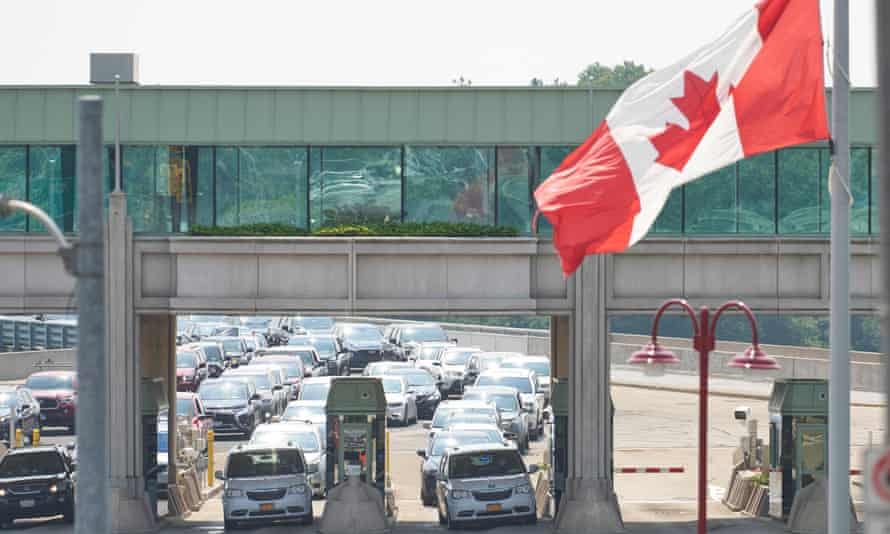 Travellers wait to cross the US border into Canada.