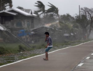 Strong winds batter a villager in Baggao, the Philippines