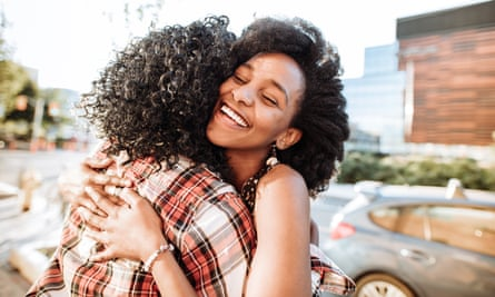 Young women hugging in the street