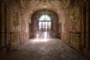 An abandoned house in Italy captured by 'Urban photographer' Roman Robroek. See Masons copy MNABANDONED: This stunning series of pictures reveal the interiors of beautiful but abandoned buildings across Europe. The images show crumbling frescoes inside deserted villas, overgrown palace conservatories and winding castle staircases. 'Urban photographer' Roman Robroek spent five years scouring the continent to find and photograph the grandest examples of forgotten architectural beauty.