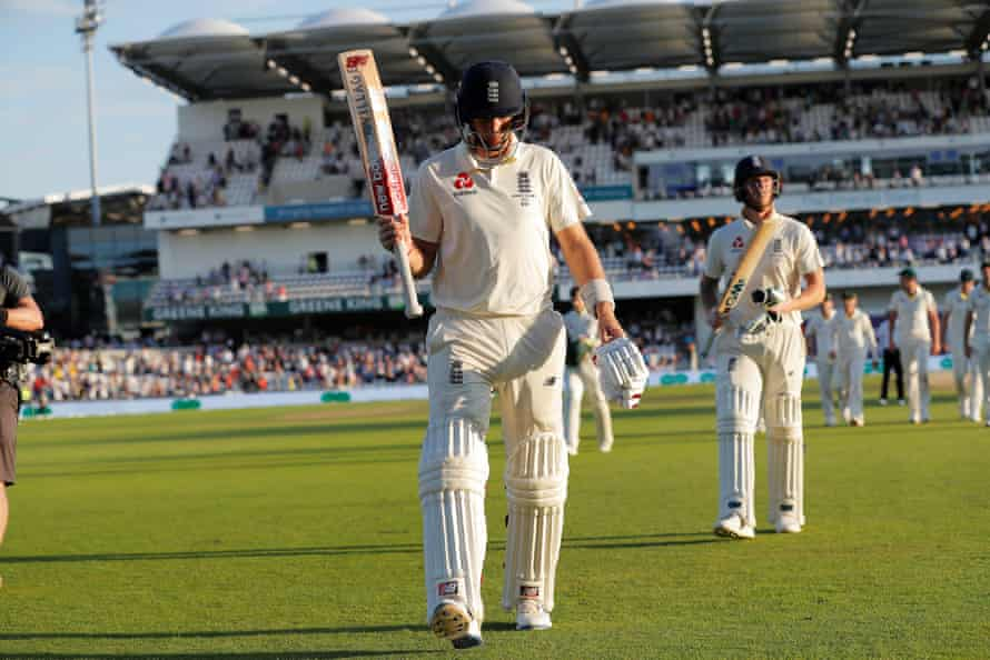 Joe Root walks off the field at the end of play on day three.
