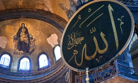 Virgin Mary and child fresco (L) and a calligraphic roundel bearing the name of Allah and other Muslim prophets hanging on the dome of the Hagia Sophia museum,Istanbul.