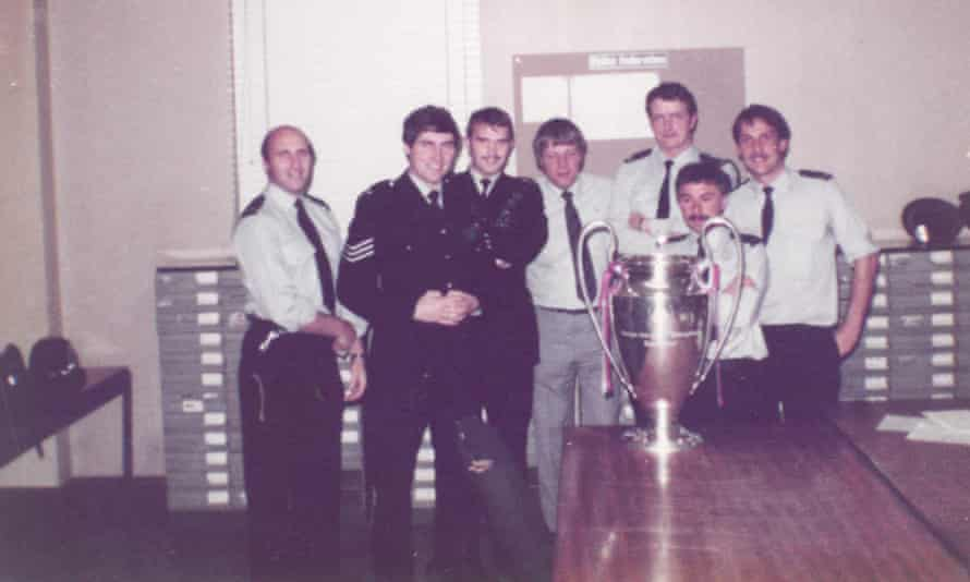 Peter Darling, second left, and Sheffield police colleagues pose with the European Cup in 1982.