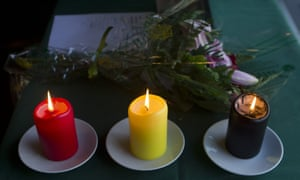 Candles in the colours of the Belgian national flag are lit inside the Belgian embassy in Madrid, Spain