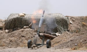 Syrian Democratic Forces fighters fire a mortar shell towards positions held by Isis in Raqqa.