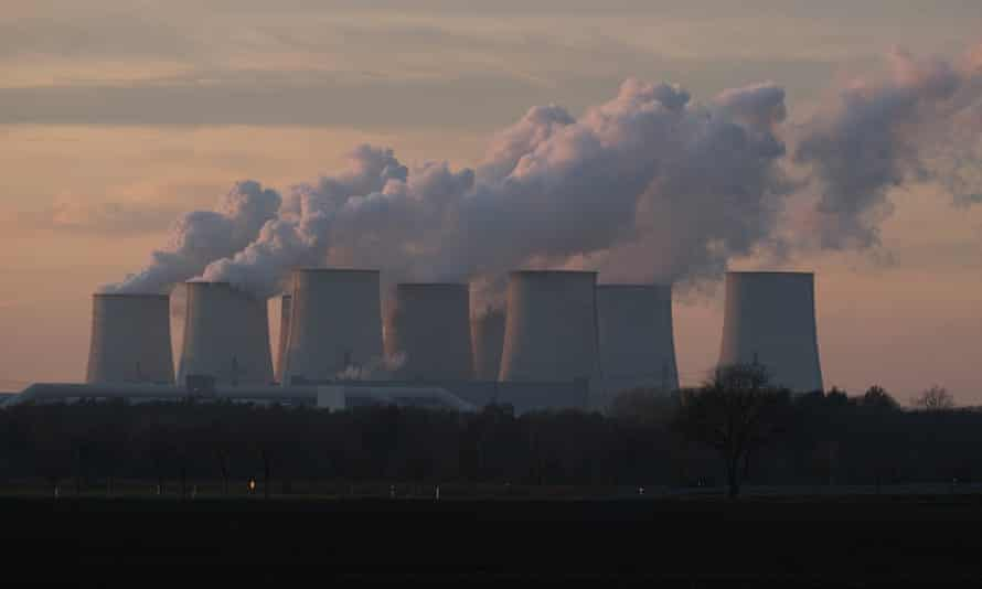 Steam rises from cooling towers at the Jaenschswalde lignite coal-fired power plant on January 15, 2020 near Peitz, Germany.