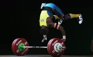 Australia's Francois Etoundi somersaults after a lift in the men 77kg weightlifting final.
