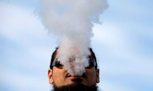 A demonstrator vapes during a rally outside of the White House to protest the proposed vaping flavor ban in Washington DC on 9 November 2019.