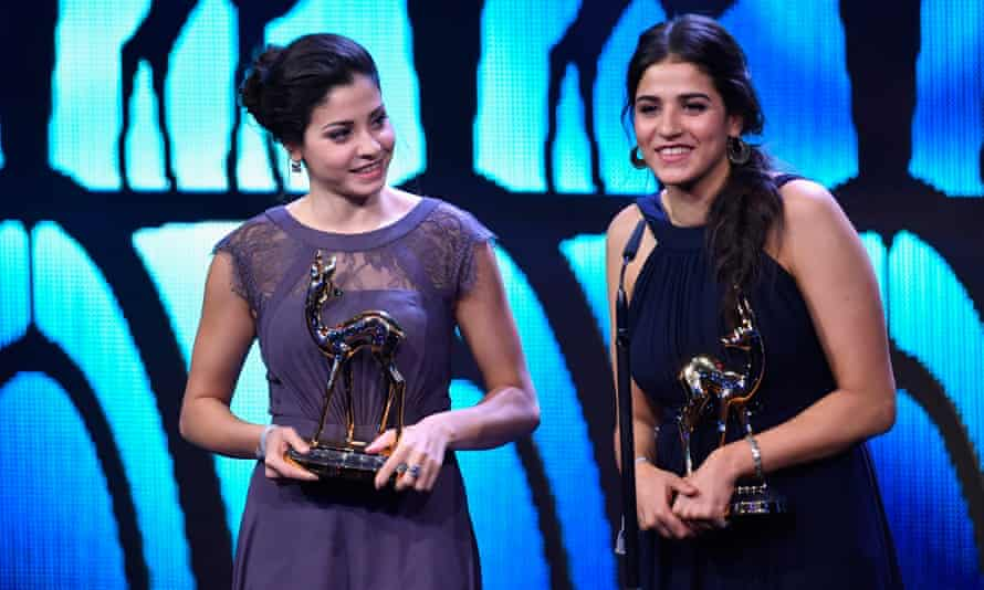 Yusra and Sarah Mardini collect their Bambi awards at the Stage theatre in Berlin, Germany, in 2016.