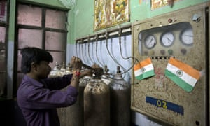 A staff member checks newly arrived oxygen cylinders at Baba Raghav Das hospital in Gorakhpur