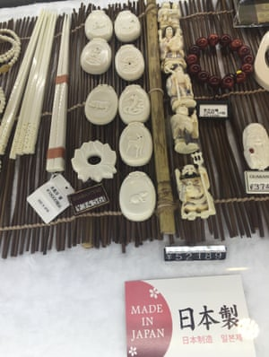 """Ivory products, with a tag saying """"Made in Japan"""" on sale in Tokyo's tourist area. Conservation groups say Japan's lax controls over its domestic stock of ivory are encouraging illegal exports to other countries and undermining efforts to end trafficking in elephant tusks."""