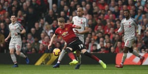 McTominay goes down after being tripped by Fabinho.