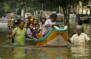 Volunteers rescue people from a residential area in Chennai, India, during the December 2015 floods