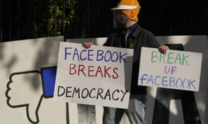 A demonstrator protests outside of Facebook CEO Mark Zuckerberg's home.