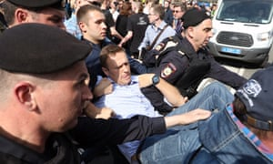 Russian opposition leader Alexei Navalny is detained by police at a opposition protest in Moscow on 5 May.