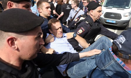 Opposition leader Alexei Navalny is arrested earlier this year at an unauthorised protest in Moscow.