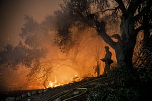 Carpinteria, California, US. A fire crew provides structure protection in the Shepard Mesa neighbourhood as a wildfire rages overnight