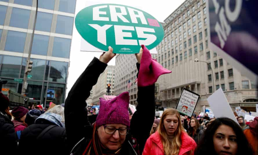 A demonstrator holds a sign supporting the Equal Rights Amendment during the Women's March in Washington DC, on 19 January 2019.