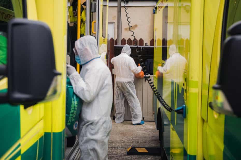 A team of Hatzola volunteers in full PPE clean ambulances