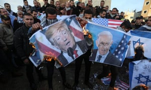 Palestinians protest Trump's plan in Rafah, in the Gaza Strip.
