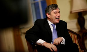 Gordon Brown laughing during a meeting with a group of school pupils to discuss his plans for education.