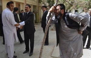 Pakistani lawyers mourn the deaths of their colleagues.