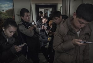 The 'standing room' section of a crowded train between Beijing and Shijiazhuang