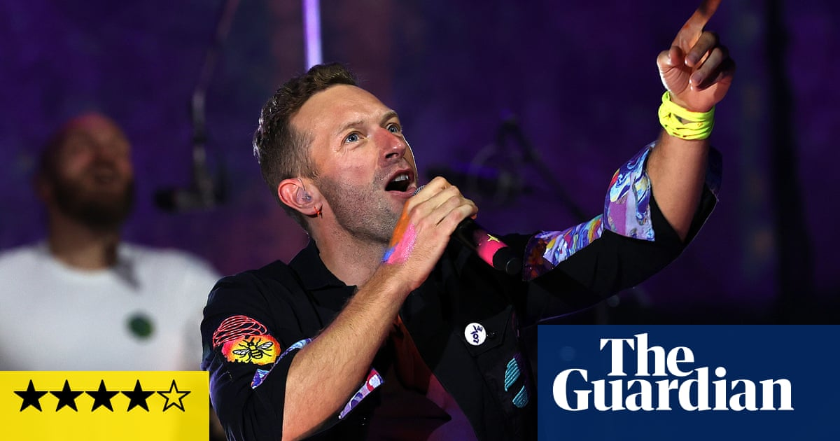 Coldplay review – lasers, confetti and Ed Sheeran in extravagant return