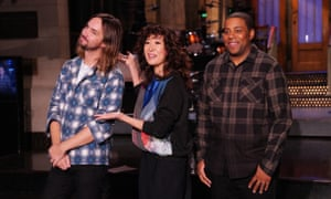 Kevin Parker of musical guest Tame Impala, host Sandra Oh, and Kenan Thompson during promos.