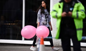 A girl wearing a T-shirt of US singer Ariana Grande in Manchester on Tuesday, the day after an explosion killed 22 people leaving her concert at the Manchester Arena