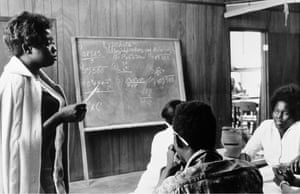 A volunteer maths teacher with students at Tufts, Mound Bayou, Mississippi 1968