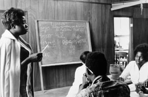 A volunteer maths teacher with students at Tufts Mound Bayou, Mississippi, 1968 by Doris Derby.