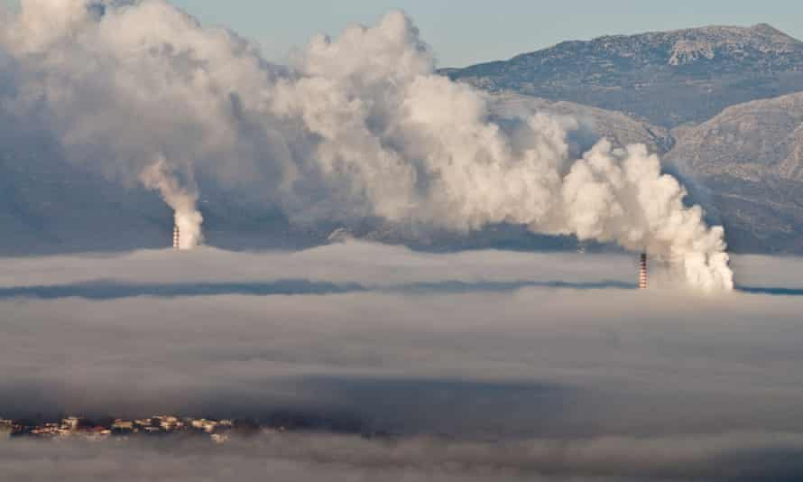 The town of Megalopoli bottom left shrouded in fog, and smog from the local power stations, Arcadia, Greece