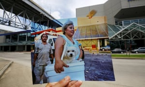 A woman arrives with her dog at a collection point for victims of Hurricane Katrina