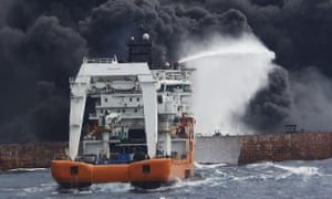 A salvage ship sprays foam on the stricken oil tanker Sanchi in the East China Sea.