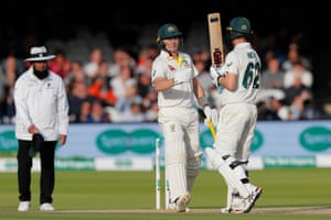 Labuschagne is congratulated by Head as he celebrates scoring a half century.